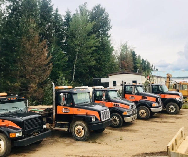 These trucks are a part of Bishop Towing & Salvage's fleet. You can easily recognize our tow trucks from the bright orange and black colours.