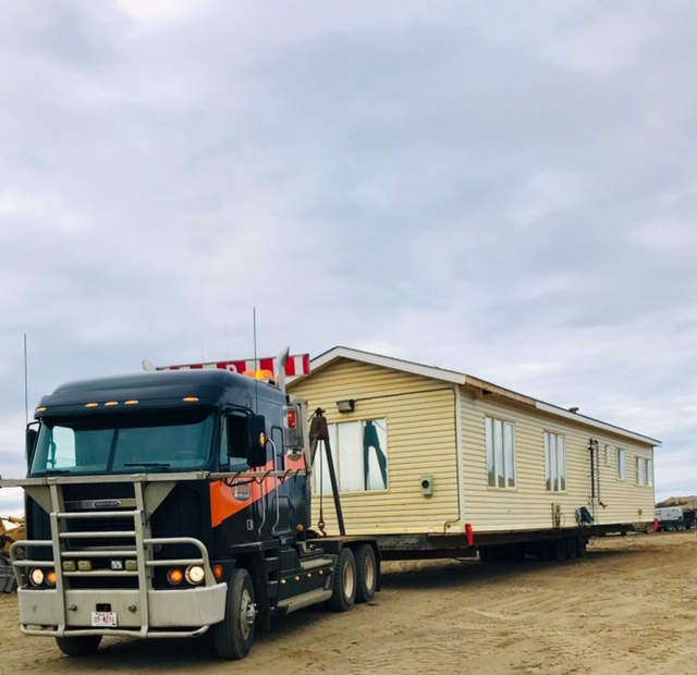 Bishop Towing & Salvage specializes in the moving of mobile homes.