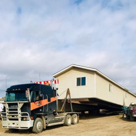 Our crew is loading a mobile home.